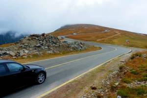 Picture of a car traveling along the Transalpina Road in Romania